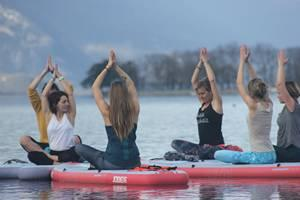 1. Stand Up Paddle Yoga